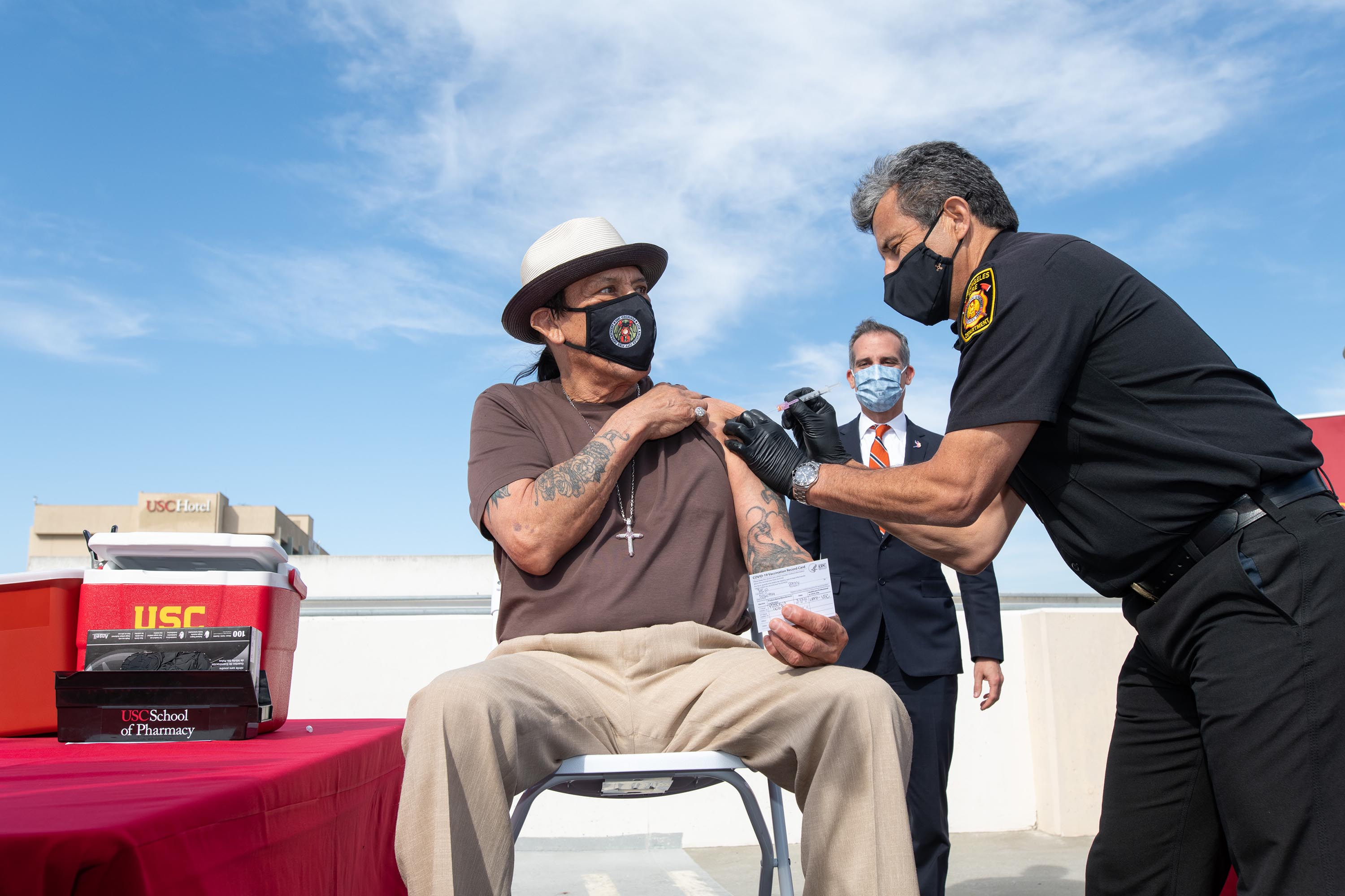 District 2 – Supervisor Holly J Mitchell<br> <b>March 24, 2021 - Actor Danny Trejo gets his COVID-19 vaccination at USC.</b><br><i>Photo by Bryan Chan / Board of Supervisors</i>