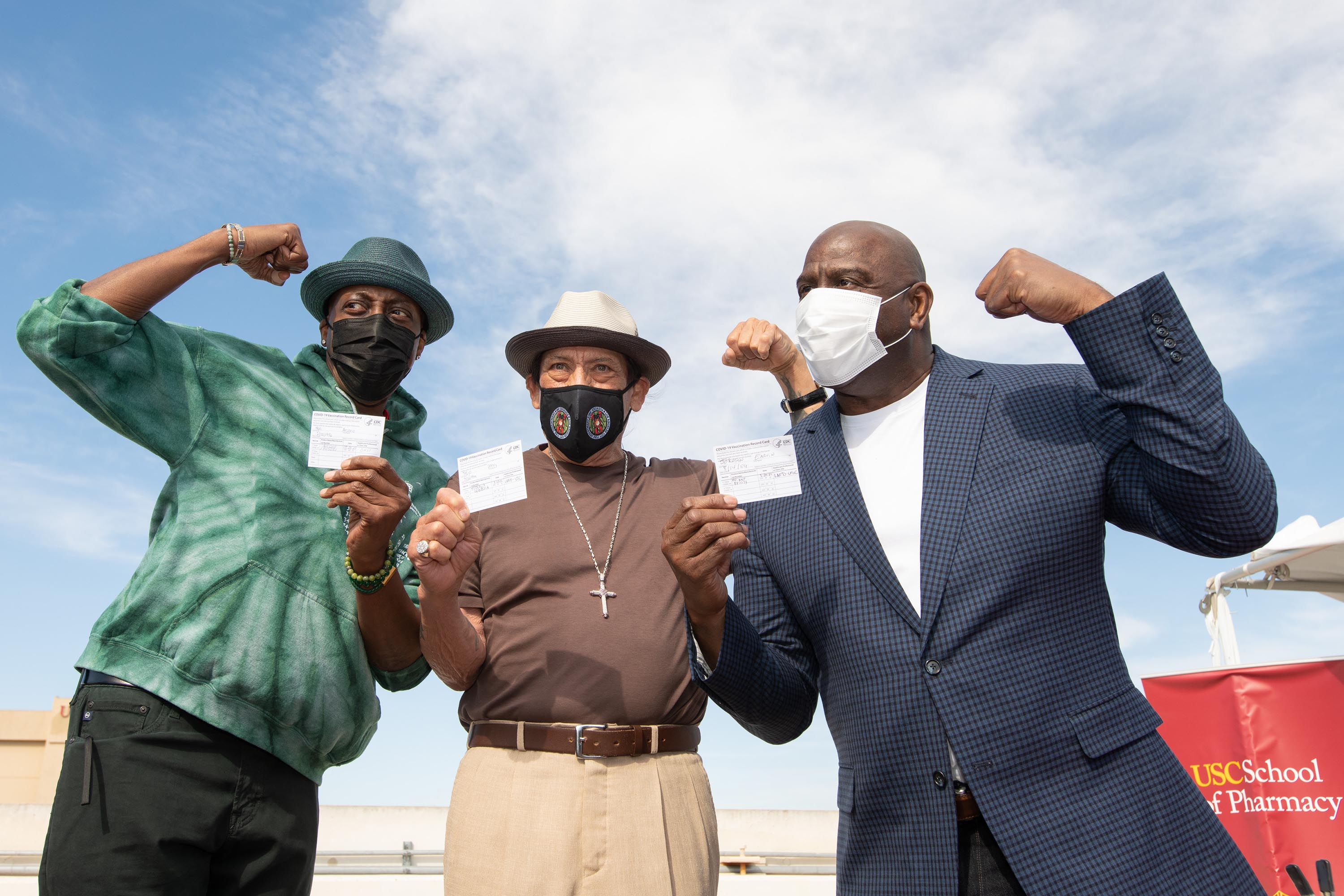 District 2 – Supervisor Holly J Mitchell<br> <b>March 24, 2021 - Arsenio Hall, Danny Trejo, and Earvin Magic Johnson show off their COVID-19 vaccination cards after getting their first dose at USC.</b><br><i>Photo by Bryan Chan / Board of Supervisors</i>